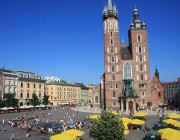 Bustling main square in Krakow on a sunny day