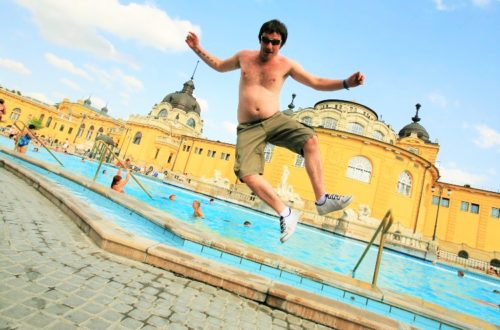 Man jumping at baths in Budapest