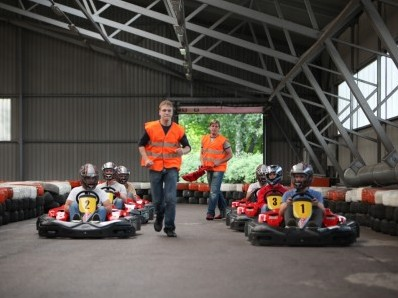 Hitting their marks, drivers in karts ready to race