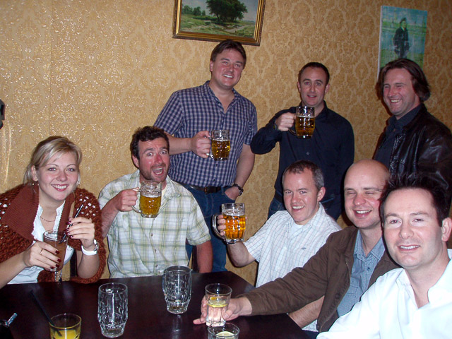 Lads with beers on Riga pub crawl