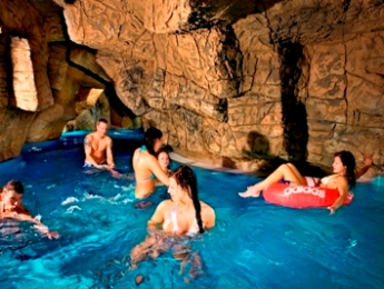 Floating on innertubes through the caves in the Riga waterpark