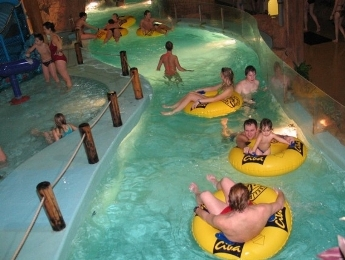 Floating on innertubes on the lazy river at the Riga waterpark