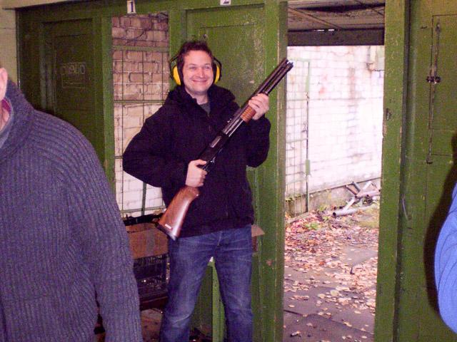 Stag holding on a shotgun at Riga shooting range