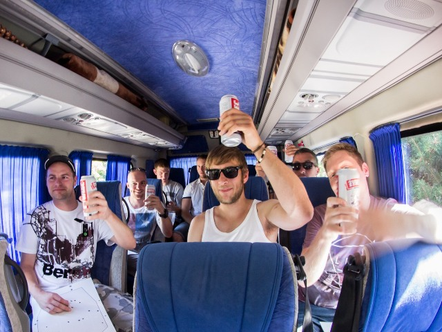 Stag group with beers on the minibus transfer