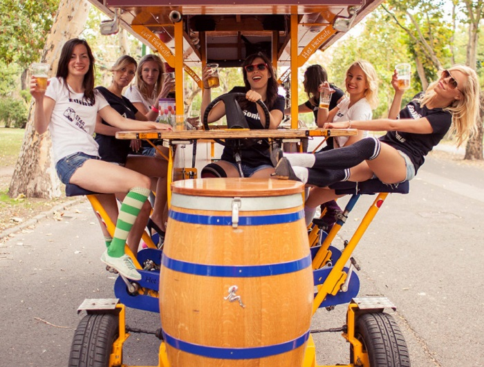 Local guides on the beer bike