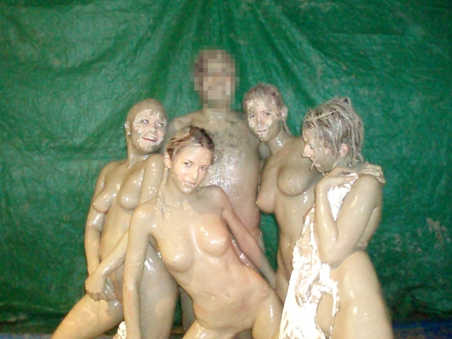 After the mud wrestling match the stag poses with strippers