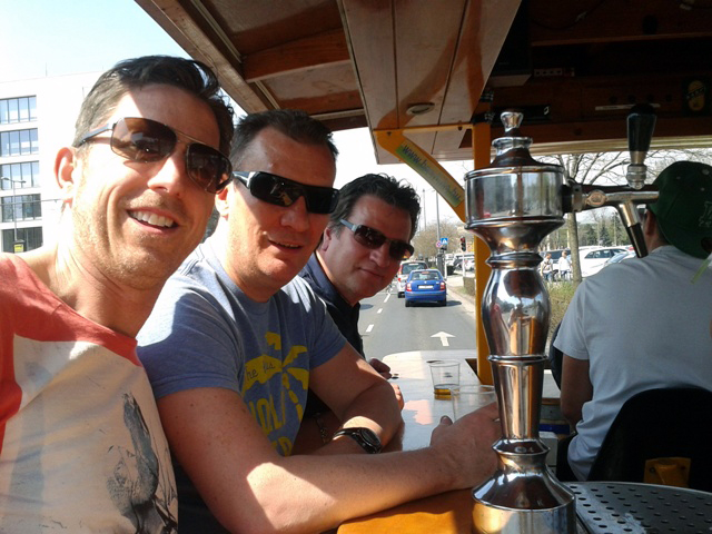 Three lads on the beer bike in Budapest