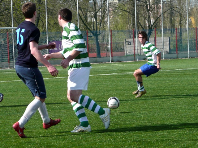 Outdoor full pitch football game against a local team