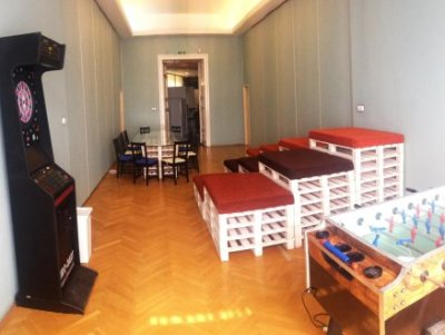 Darts, table football in games room of Budapest hostel