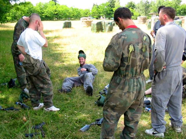 Picture of stag group resting in a sunny field after paintball