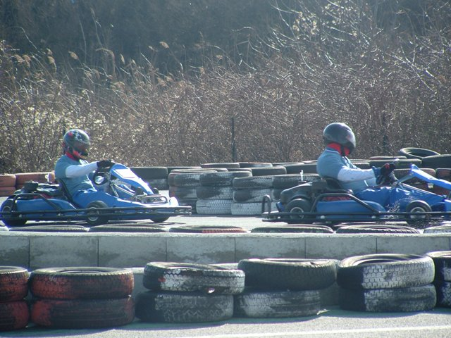 Driving at top speeds on outdoor go kart track