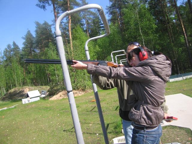 Local Riga guide Tamara blasting a clay pigeon