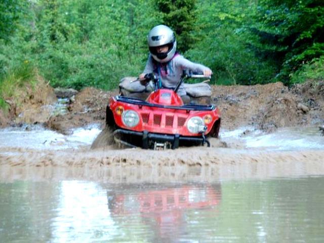Crossing a muddy stream with a quad bike