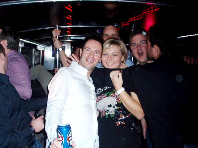 Happy stag group with guide on Riga party bus