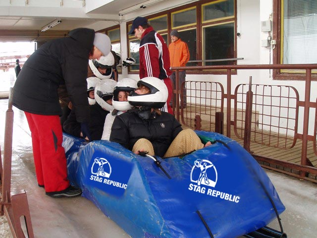Lads on a stag do getting ready to whiz down the icey bobsled chutes