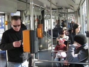 Man stamping ticken on tram in Krakow