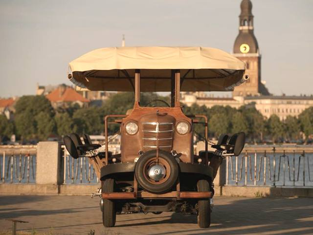 A beautiful photo of the beer bike with Riga's clock tower in the background