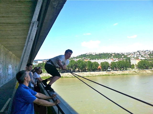 A stag party swinging from a bridge in Bratislava.